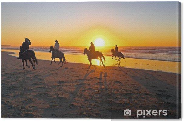 Obraz na płótnie Jazda konna na plaży o zachodzie słońca - Sporty indywidualne