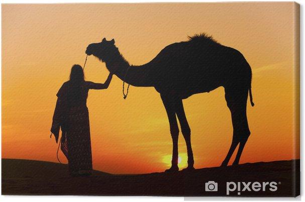 Obraz na płótnie Kobiety gospodarstwa wielbłąda Thar Desert, Rajasthan - Indie - Azja