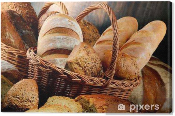 Obraz na płótnie Kompozycja z różnych produktów piekarniczych na drewnianym stole - Jedzenie