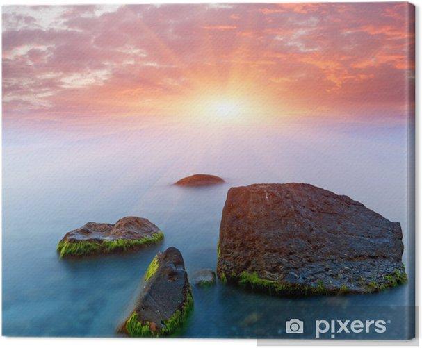 Obraz na płótnie Ładny zachód słońca nad morzem - Woda