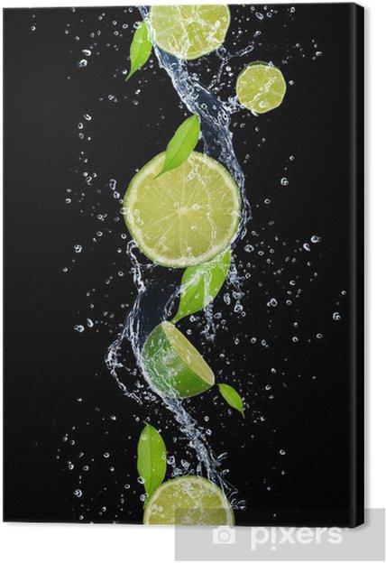 Obraz na płótnie Limes w plusk wody, odizolowane na czarnym tle -