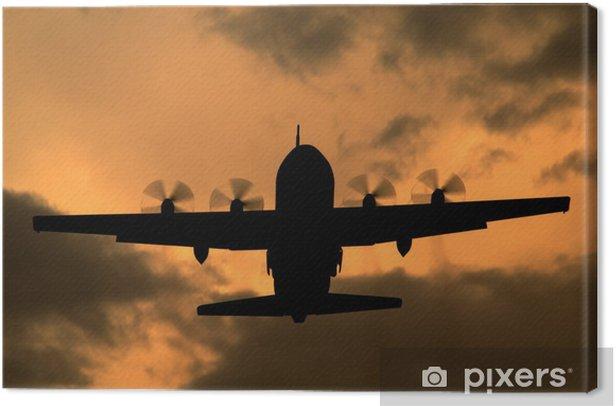 Obraz na płótnie Lockheed C-130 Hercules turbośmigłowy samolot cargo na zachodzie słońca - Transport powietrzny