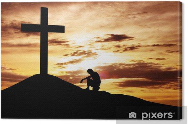 Obraz na płótnie Mężczyzna siedzi rozpaczliwie pod krzyżem - Religie
