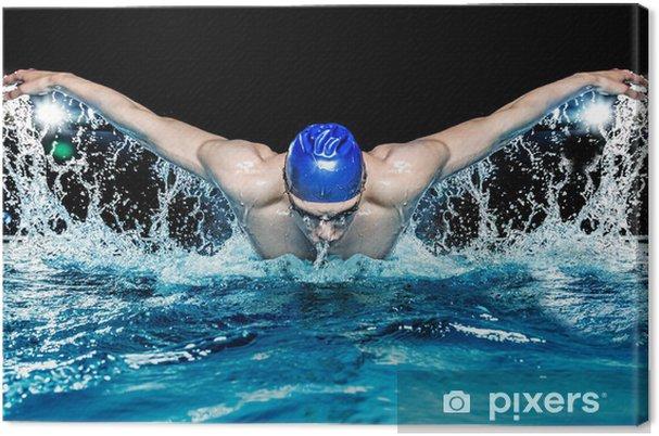 Obraz na płótnie Mięśni młody człowiek w niebieskiej w basenie - Sporty indywidualne