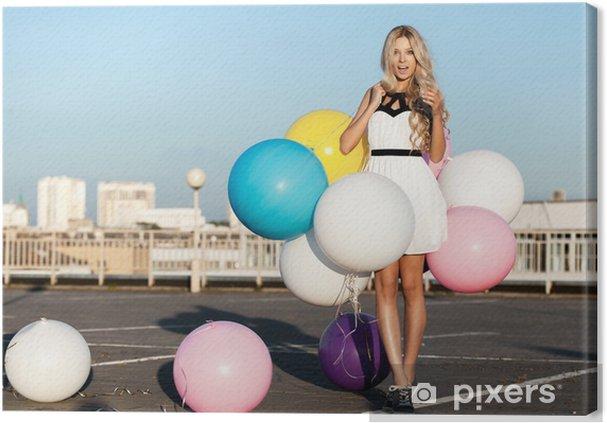 Obraz na płótnie Młoda kobieta z kolorowych balonów lateksowych - Szczęście
