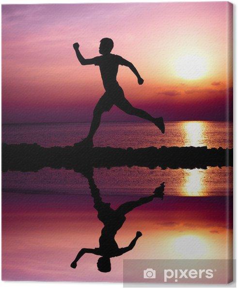 Obraz na płótnie Młody zawodnik z wodą odzwierciedlając - Sporty indywidualne