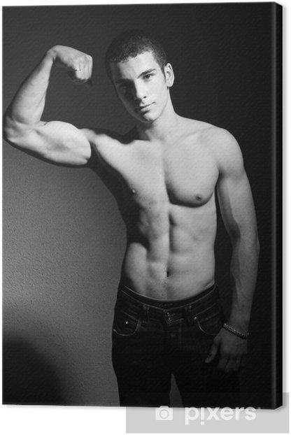 Obraz na płótnie Muscular młody człowiek - Mężczyźni