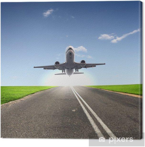 Obraz na płótnie Obraz z białym samolotu pasażerskiego - Transport powietrzny