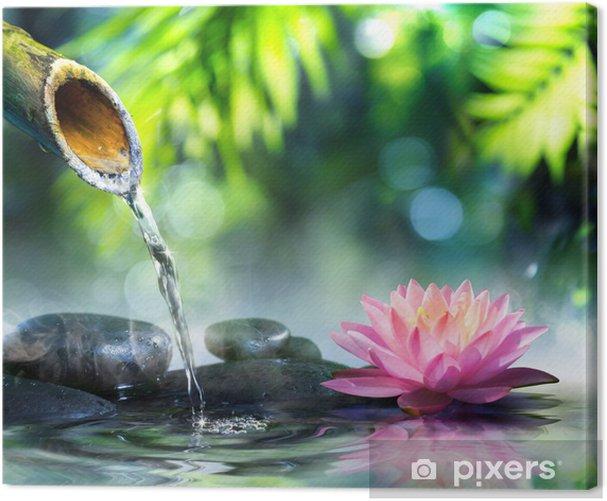 Obraz na płótnie Ogród zen z czarnych kamieni i różowym lilii wodnej - iStaging