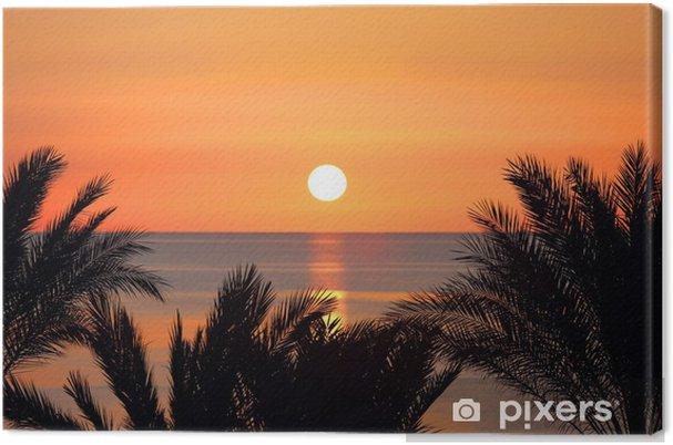 Obraz na płótnie Palmy i wschód słońca nad morzem - Niebo