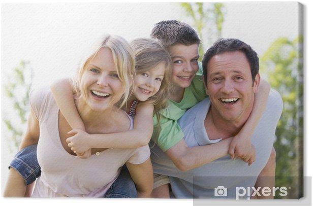Obraz na płótnie Para dając dwie młode uśmiechnięte dzieci przejażdżki kombinowanym - Szczęście