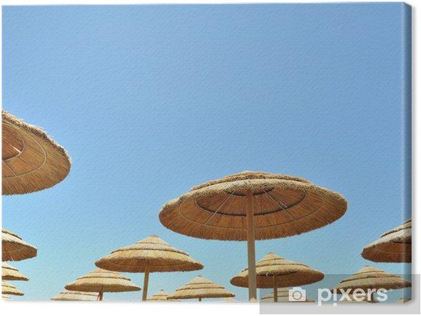 Obraz na płótnie Parasole bambusowe z nieba - Wakacje