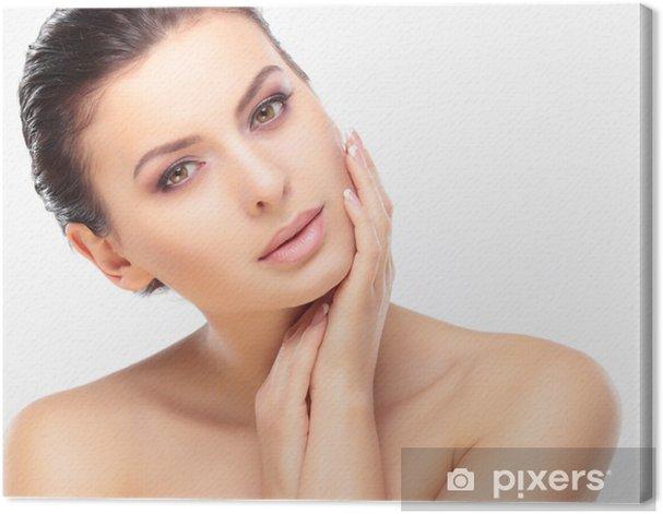 Obraz na płótnie Piękna dziewczyna dotyka jej twarzy. Pielęgnacja twarzy. - Uroda i pielęgnacja ciała