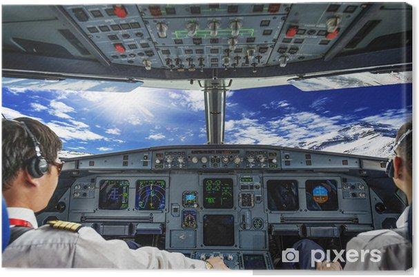 Obraz na płótnie Piloci w kokpicie samolotu - Transport powietrzny