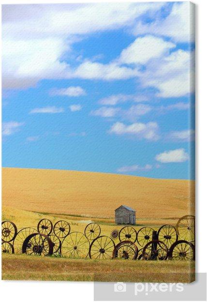 Obraz na płótnie Pola pszenicy i starego ogrodzenia Wagon Wheel - Krajobraz wiejski