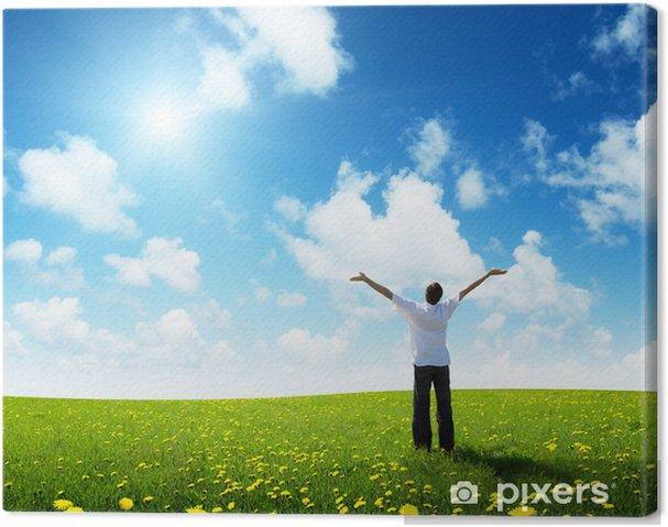 Obraz na płótnie Pole trawy i szczęśliwy młody człowiek - Rolnictwo