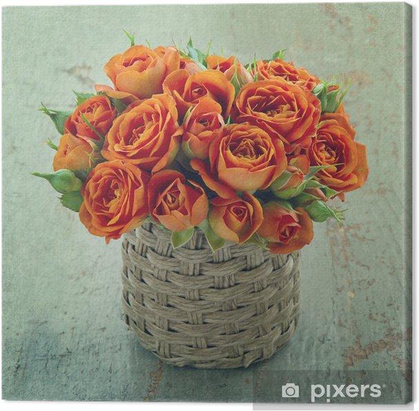 Obraz na płótnie Pomarańczowy róż na tle drewniane - Kwiaty
