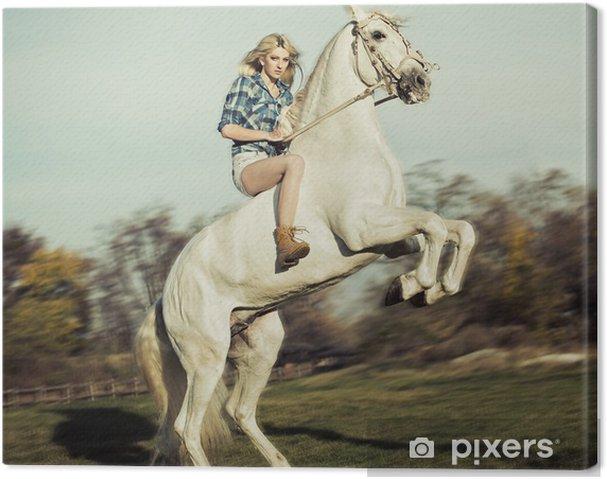 Obraz na płótnie Poważne blondynka jedzie na koniu - Tematy