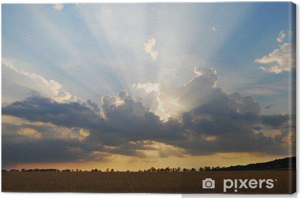 Obraz na płótnie Promienie słoneczne - Niebo