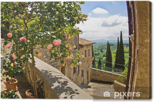 Obraz na płótnie Róże na balkonie w San Gimignano, Toskania krajobraz w tle - Tematy