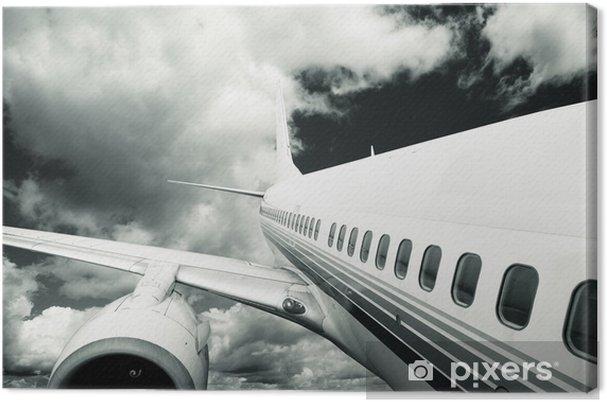 Obraz na płótnie Samolot z niebieskim tle nieba. - Transport drogowy
