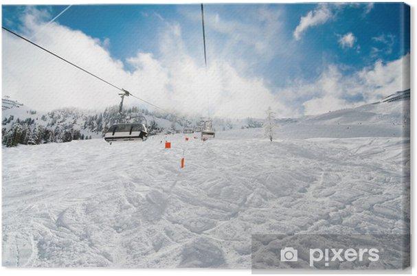 Obraz na płótnie Scenicznego widok z wyciągu narciarskiego w Alpach w zimie w regionie narciarskim - Wakacje