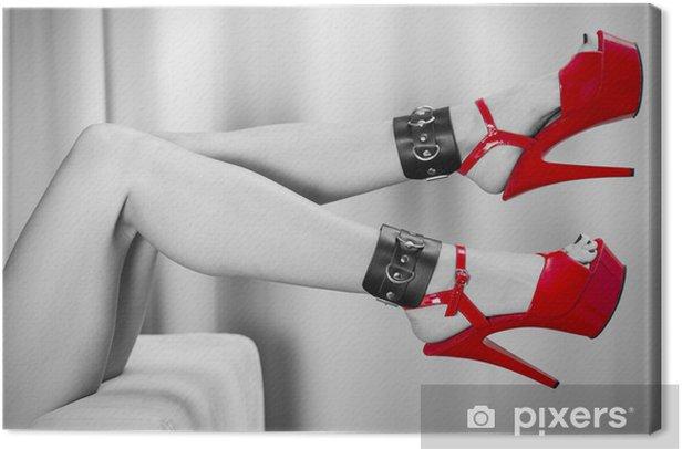 Obraz na płótnie Sexy nogi z mankietami kostki i czerwone buty na obcasie - Tematy