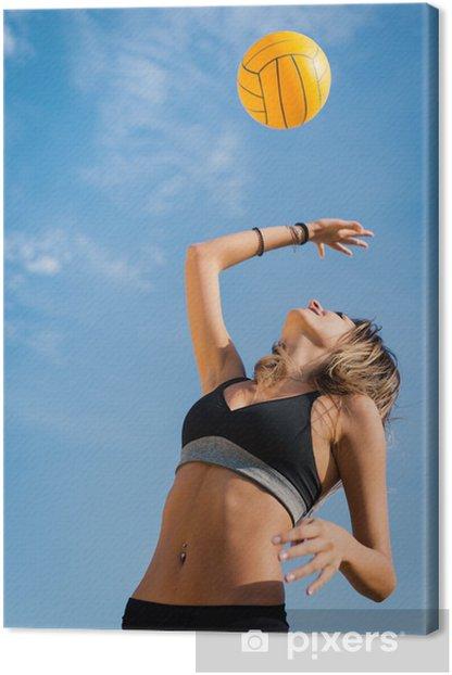 Obraz na płótnie Skoki do siatkówki plażowej kobiet gracz serwującą piłkę. - Tematy