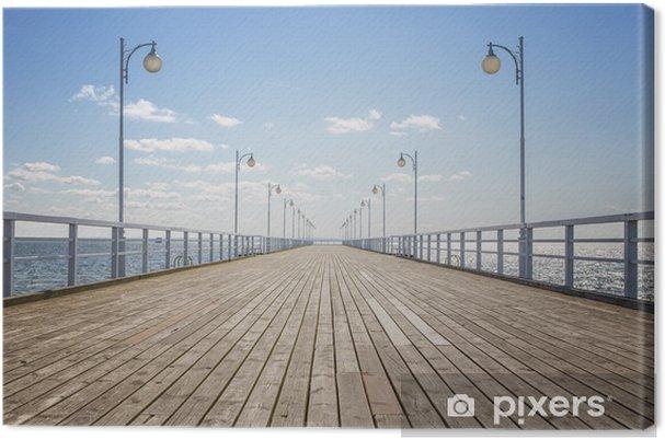 Obraz na płótnie Stare drewniane molo na pusty brzeg morza z miejsca na kopię - Style