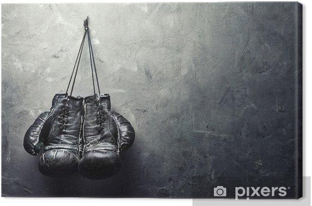 Obraz na płótnie Stare rękawice bokserskie powiesić na gwoździu na ścianie tekstury - Styl życia