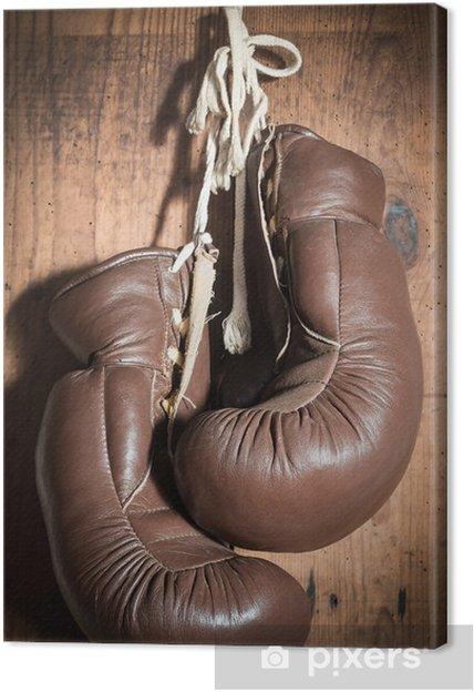 Obraz na płótnie Stare rękawice bokserskie, wiszące na drewnianej ścianie - Tematy