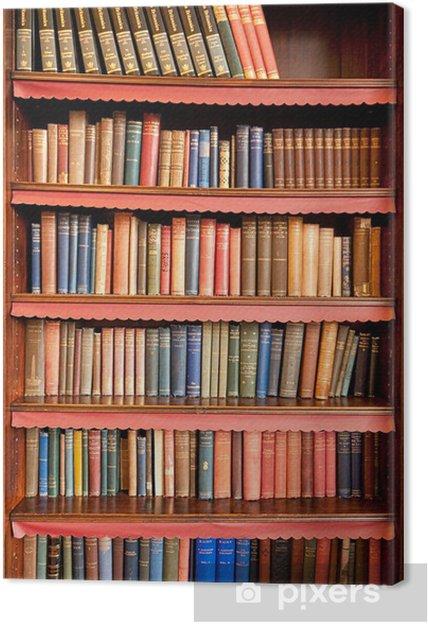 Obraz na płótnie Stary regał z rzędami książek w starożytnej bibliotece - Biblioteczka