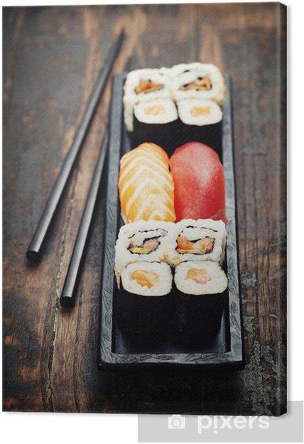 Obraz na płótnie Sushi pałeczkami - Sushi