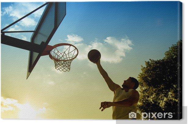 Obraz na płótnie Sylwetka koszykarz na zachodzie słońca - Sporty drużynowe