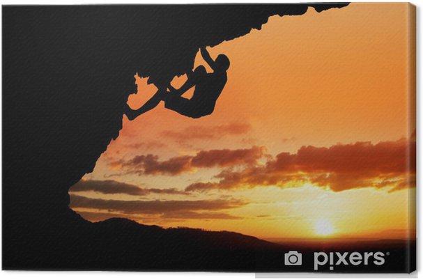 Obraz na płótnie Sylwetka wspinacza w wolnej słońca -
