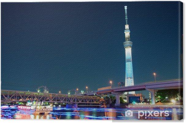 Obraz na płótnie Tokio skytree niebieskie podświetlenie obok rzeki Sumida - Tematy