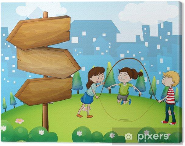 Obraz na płótnie Trzy dzieci bawiące się w ogrodzie z drewnianymi strzałkami - Inne uczucia