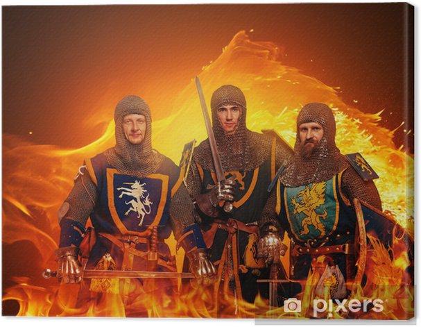 Obraz na płótnie Trzy średniowiecznych rycerzy na tle płomieni. - Mężczyźni