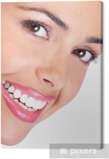 Obraz na płótnie Uśmiechnięta młoda kobieta twarz. Na białym tle. - Tematy
