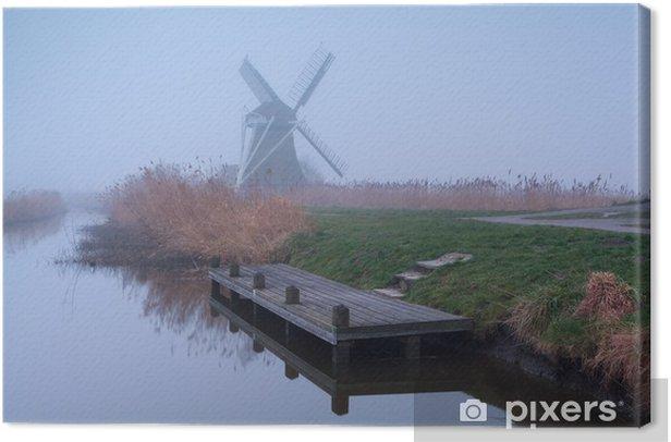 Obraz na płótnie Wiatrak przez rzekę w gęstej mgle - Pory roku