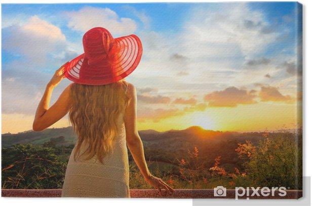 Obraz na płótnie Widok z boku z powrotem na pięknej młodej kobiety, oglądając zachód słońca. - Dom i ogród