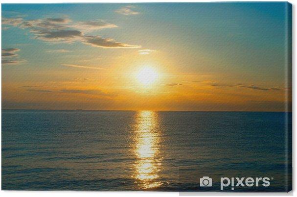 Obraz na płótnie Zachód słońca na morzu - Niebo