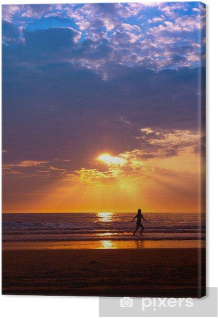 Obraz na płótnie Zachód słońca na plaży - Woda