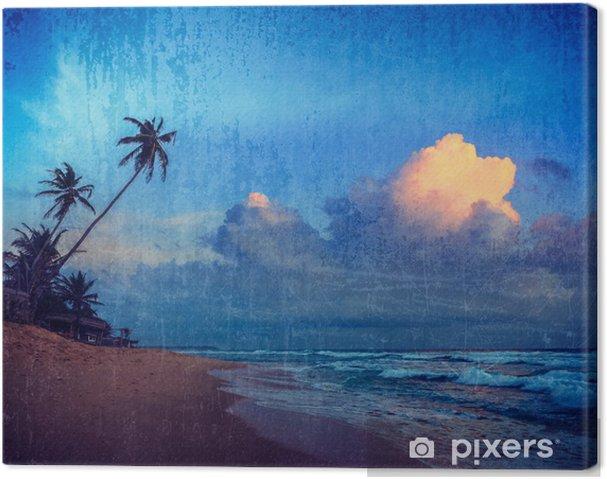 Obraz na płótnie Zachód słońca na tropikalnej plaży - Wakacje