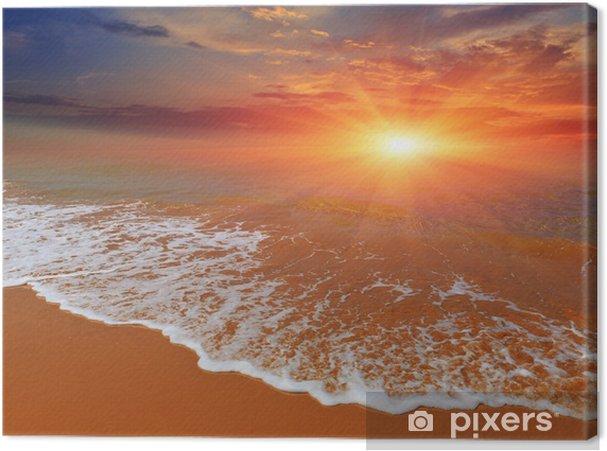 Obraz na płótnie Zachód słońca nad wybrzeża morskiego - Woda