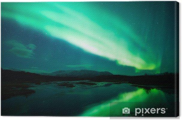 Obraz na płótnie Zorza polarna nad laguną w Islandii - Tematy