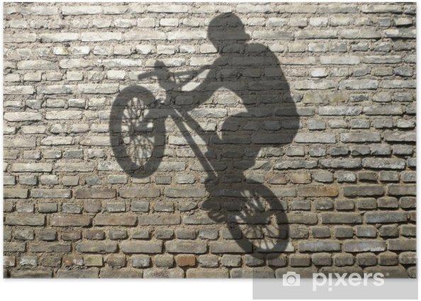 Plakat Cień człowieka w BMX na ceglany mur - Kolarstwo