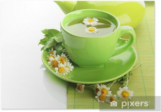 Plakat Filiżanka i czajniczek herbaty ziołowej z dzikich camomiles i miętą, - Gorące napoje