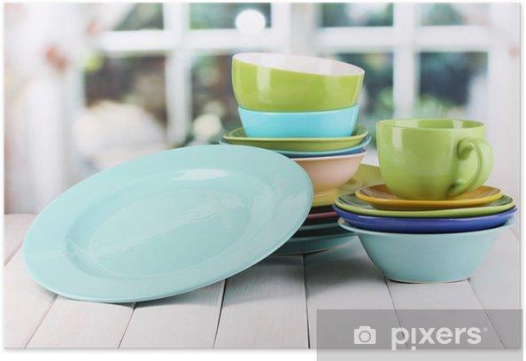 Plakat Kolorowe naczynia na drewnianym stole na tle okna - Tematy