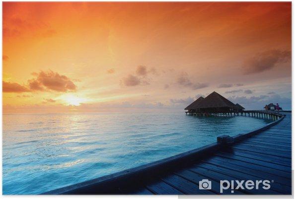 Plakát Maldivian domy na východ slunce - Témata